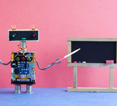Robot teacher explains modern theory. Classroom interior with empty black chalkboard. Pink blue colorful background.